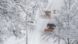 A snow plough clears the road from the snow in Switzerland. According to media reports heavy snowfalls hit many European countries during a weekend. EPA/GABRIELE PUTZU