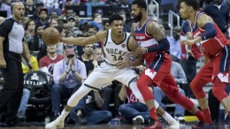 Milwaukee Bucks forward Giannis Antetokounmpo (L) drives to the basket beside Washington Wizards forward Markieff Morris (C) and Washington Wizards forward Otto Porter Jr. (R) during the second half of their NBA game at Capital One Arena in Washington, DC, USA. EPA, MICHAEL REYNOLDS