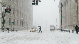 People walk in the street in New York, New York, USA. A Nor'easter snow storm brought to up 8 inches (20 cm) of snow in the New York area. EPA, ALBA VIGARAY