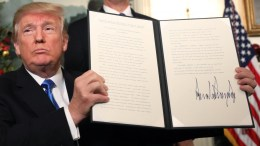 File Photo: US President Donald J. Trump (L) signs his proclamation about his controversial decision to formally recognize Jerusalem as the capital of Israel, and his plan to relocate the US embassy to that city, in the Diplomatic Room of the White House in Washington, DC, USA 06 December 2017. EPA, JIM LO SCALZO