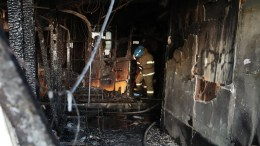 A firefighter operates in a damaged emergency room of a hospital after it was burned by a fire in Miryang, South Korea, 26 January 2018. EPA/YONHAP SOUTH KOREA OUT