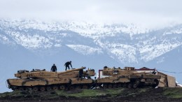 Turkish soldiers with their tanks and armored vehicles near Syrian-Turkish border. FILE PHOTO. EPA/SEDAT SUNA