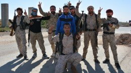 File Photo: Fighters from Syrian Democratic Forces (SDF) pose for picture at the northern entrance of Al-Raqqa, Syria. FILE PHOTO. EPA, YOUSSEF RABIH YOUSSEF