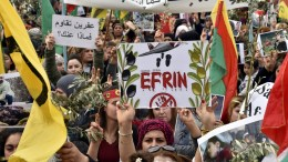 Kurdish protesters carry national flags, olive branches, and placards as they shout slogans during a protest against what they call the 'Turkish aggression' in northern Syria, near the US embassy in Awkar, east of Beirut, Lebanon, 05 February 2018. The Turkish army is on an operation named 'Operation Olive Branch' in Syria's northern regions against the Kurdish Popular Protection Units (YPG) forces which control the city of Afrin. EPA, WAEL HAMZEH