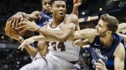 Milwaukee Bucks forward Giannis Antetokounmpo of Greece (C) battles for a rebound , File Photo, EPA, TANNEN MAURY