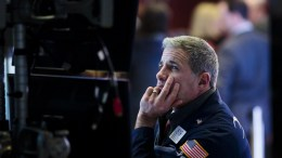 A trader works on the floor of the New York Stock Exchange in New York, New York, USA. EPA, JUSTIN LANE