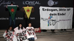 A group of pro Kurdish demonstrators stage a pop up protest with a placard reading 'Erdogan, Afrin is your end!' near the red carpet of the premiere of 'Museo' during the 68th annual Berlin International Film Festival (Berlinale), in Berlin, Germany, 22 February 2018. EPA, PHILIPP GUELLAND