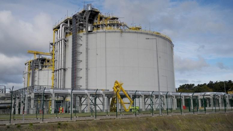 Workers repair installation in a gas terminal. FILE PHOTO,  EPA, MARCIN BIELECKI POLAND OUT