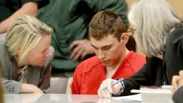Nikolas Cruz (C) appears in court for a status hearing before Broward Circuit Judge Elizabeth Scherer in Fort Lauderdale, Florida, USA, 19 February 2018. Cruz is facing 17 charges of premeditated murder in the mass shooting at Marjory Stoneman Douglas High School in Parkland, Florida. EPA, MIKE STOCKER/ POOL