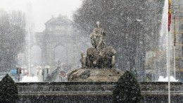 Cibeles fountain stands during a snowstorm in donwntown Madrid, Spain, 05 February 2018. Almost all the regions of Spain are under alert due to snowy weather with some 332 highways and mountain passes affected by snow and ice, some 44 of them closed to traffic.E EPA/Juan Carlos Hidalgo