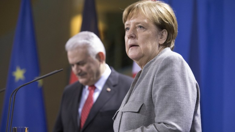 File Photo: German Chancellor Angela Merkel (R) and Turkish Prime Minister Binali Yildirim (L) address the media during a joint news conference following their meeting at the Chancellary, in Berlin, Germany. EPA, OMER MESSINGER
