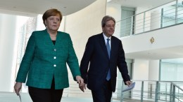 German Chancellor Angela Merkel (L) and Italian Prime Minister Paolo Gentiloni (R) enter the room for a joint press conference after their lunch at the chancellery in Berlin, Germany, 16 February 2018. In the previous lunch they talked about bilateral relations, European and international issues. EPA,MARKUS HEINE
