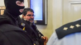 Prominent Syrian-Kurdish leader Salih Muslim Muhammad is escorted by Czech police for trial at the municipal court in Prague, Czech Republic, 27 February 2018. EPA, STRINGER