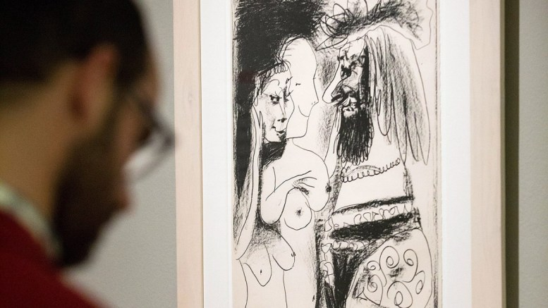 A visitor looks at the drawing 'Old man and the King' by Spanish artist Pablo Picasso at 'The captured desire' exhibition at the Picasso Foundation in Malaga, southern Spain. FILE PHOTO. EPA, DANIEL PEREZ