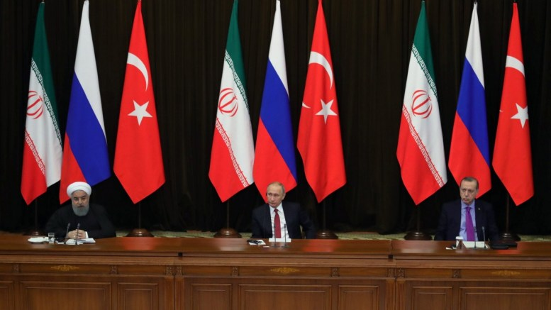 File Photo: Russian President Vladimir Putin (C), Iranian President Hassan Rouhani (L) and Turkish President Recep Tayyip Erdogan (R) attend a joint news conference in Sochi, Russia. EPA, MICHAEL KLIMENTYEV. SPUTNIK, KREMLIN POOL MANDATORY CREDIT
