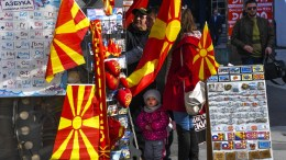 People look for souvenirs at a stall at the main square of the capital Skopje, The FYROM, 06 February 2018. Prior to the resolution of the negotiations with Athens (Greece) on the name dispute, the public in FYROM is eagerly awaiting the EU's strategy for the future of the Western Balkans. EPA, GEORGI LICOVSKI