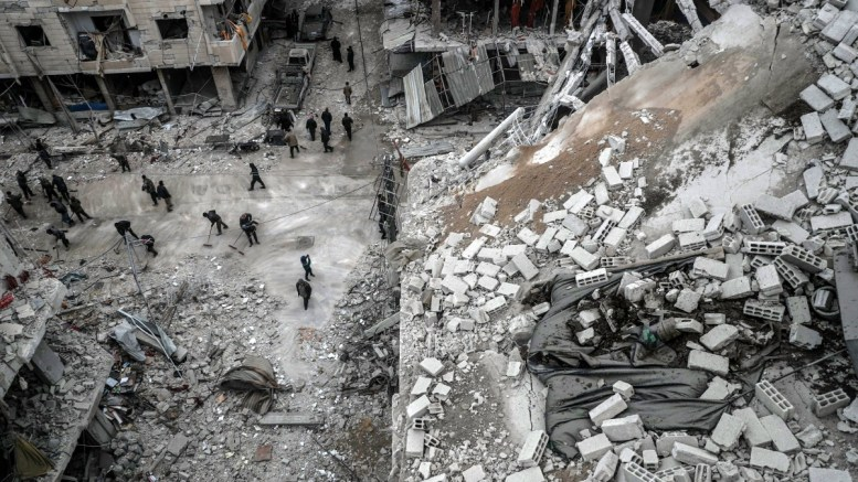 People inspect the rubble of damaged buildings after several airstrikes a day earlier, rebels-held Douma, Eastern Ghouta, Syria. FILE PHOTO, EPA, MOHAMMED BADRA