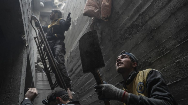 White helmet volunteers and civilians search for survivors among the rubbles after bombing, in the rebel-held Douma, Eastern Ghouta, Syria. FILE PHOTO, EPA, MOHAMMED BADRA