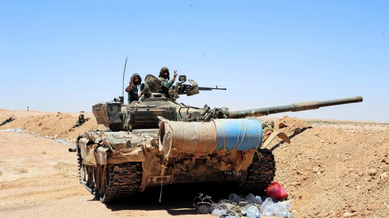 A handout photo made available by Syrian Arab news agency (SANA) shows Syrian army soldiers patrol on a tank. FILE PHOTO, EPA, SANA HANDOUT HANDOUT EDITORIAL USE ONLY, NO SALES