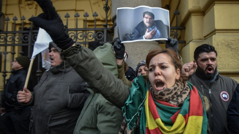 Supporters of Sahim (Saleh) Muslim protest in front of the municipal court in Prague, Czech Republic, 27 February 2018. Prominent Syrian-Kurdish leader Sahim (Saleh) Muslim, the former co-chair of the Democratic Union Party (PYD), was arrested by Czech police upon Turkey's request late on February 24 in the Czech capital, according to a statement by a coalition of political parties that includes the PYD. EPA, MARTIN DIVISEK