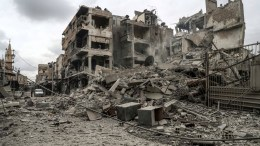 FILE PHOTO: A view of a building and a street that got bombed at Duma EPA, MOHAMMED BADRA, FILE PHOTO