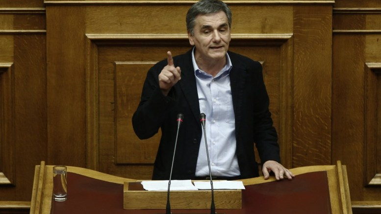 Greek Finance Minister Euclid Tsakalotos delivers his speech during a session in the parliament. FILE PHOTO, EPA, ALEXANDROS VLACHOS