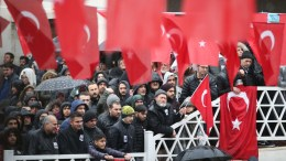 People hold Turkish flags during the funeral of Koray Karaca, a Turkish soldier who was killed in a cross-border clashes with Kurdish Popular Protection Units (YPG) forces at Afrin, in Istanbul. FILE PHOT,  EPA, ERDEM SAHIN