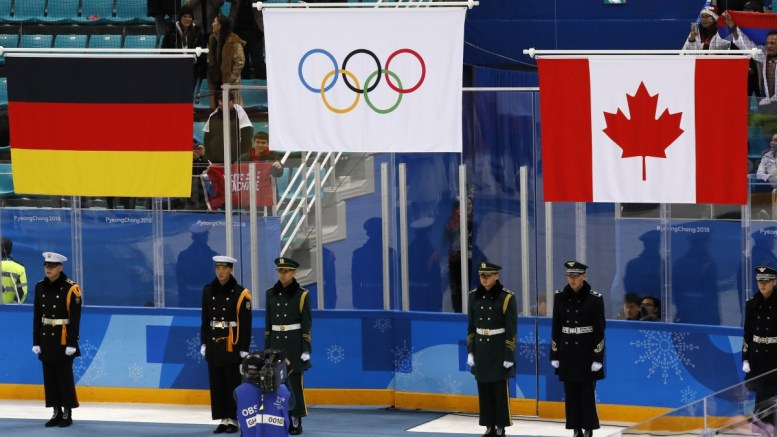 The flags of the winners, Olympic Athletes of Russia (OAR) in first place for gold, German flag for Silver and Canadian flag for Bronze, at the medal ceremony during the PyeongChang 2018 Winter Olympic Games, in Gangneung, South Korea, 25 February 2018. EPA,KIMIMASA MAYAMA