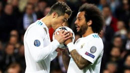 Real Madrid's Cristiano Ronaldo (L) celebrates with his teammate Marcelo (R) after scoring the 1-1 equalizer from the penalty spot during the UEFA Champions League round of 16, first leg soccer match between Real Madrid and Paris Saint-Germain (PSG) at Santiago Bernabeu stadium in Madrid, Spain, 14 February 2018. EPA, KIKO HUESCA