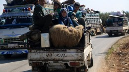 Internally displaced people from various areas under YPG control, arrive to the recently captured by the Free Syrian Army village of Qestel Cindo, Afrin EPA, AREF TAMMAWI