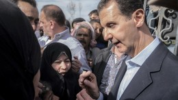 A handout photo made available by the official Syrian Arab News Agency (SANA) shows Syrian President Bashar Al-Assad (R) meeting with Syrian citizens, in Eastern Ghouta in Damascus Countryside, Syria, 18 March 2018. The Syrian army, which is carrying out a ground offensive in the region, claimed that it had captured 70 percent of the rebel-held enclave of Eastern Ghouta. EPA, SANA