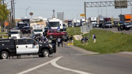 Police load the suspect's vehicle onto a flatbed trailer off Interstate 35 in Round Rock, Texas, USA, EPA, THAO NGUYEN