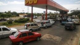 File Photo: View of cars in a line at a Gas Station of Petroleos de Venezuela in Maracaibo, Venezuela. EPA, HUMBERTO MATHEUS