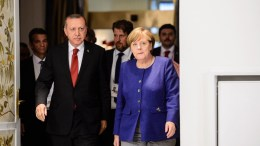 German Chancellor Angela Merkel (R) sand Turkish President Recep Tayyip Erdogan (L) in the Hotel Atlantic, in Hamburg, Germany. EPA, JENS SCHLUETER, POOL