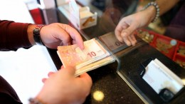 FILE PHOTO.  People exchange their money at a currency exchange office. EPA, ERDEM SAHIN