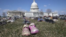 Approximately seven thousand shoes representing lost children to guns seen on the East Front of the US Capitol in Washington, DC, USA, 13 March 2018. EPA, MICHAEL REYNOLDS