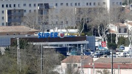 A view of the Super U supermarket where a gunman claiming allegiance to the Islamic State (IS) holding hostages in the small town of Trebes, southern France, 23 March 2018. According to reports a police officer was shot and wounded by a gunman who then opened fire and took hostages at the supermarket, killing at least one person inside, in Trebes near Carcassonne. EPA, GUILLAUME HORCAJUELO