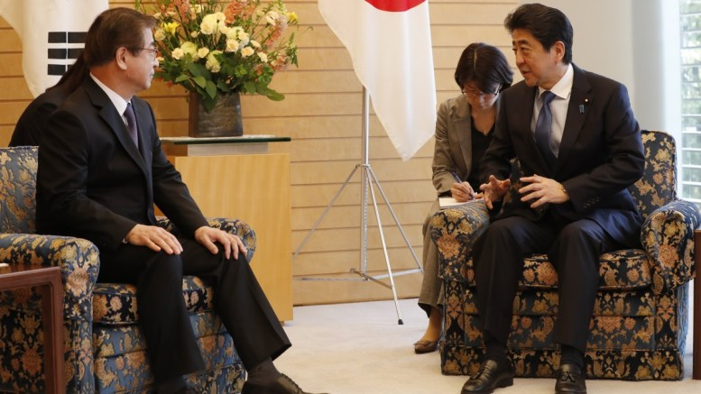 South Korea's National Intelligence Service chief Suh Hoon (L) meets Japanese Prime Minister Shinzo Abe (R) in Tokyo, Japan 13 March 2018. Suh recently met with North Korean leader Kim Jong-un and discussed the prospect of the denuclearization of the Korean Peninsula. EPA, KIM KYUNG-HOON, POOL