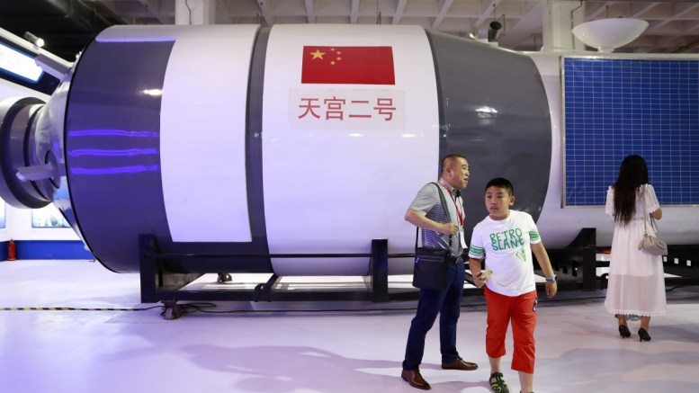 File Photo: Visitors walk in front of a replica of Tiangong-2 space laboratory on display at the China Beijing International High-Tech Expo (CHITEC) in Beijing, China. EPA, HOW HWEE YOUNG