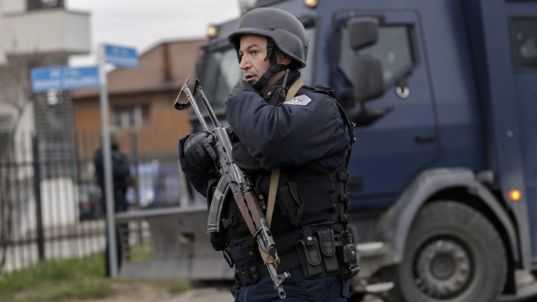 File Photo: A member of Kosovo's police special unit stay guard. EPA, VALDRIN XHEMAJ