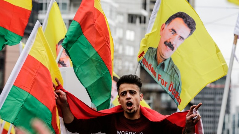 File Photo: A members of the Kurdish community carries a flag with the text, 'Freedom for Ocalan' in reference to the Kurdish nationalist leader Abdullah Ocalan, during a 'Newroz' march in Frankfurt Main, Germany. EPA, ARMANDO BABANI