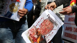File Photo: Kurdish demonstrators who live in Cyprus burn an image of the Turkey's President Recep Tayyip Erdogan during a protest against the Turkish offensive targeting Kurds in Afrin, Syria, outside of the Russian embassy in Nicosia, Cyprus, 01 March 2018. EPA, KATIA CHRISTODOULOU