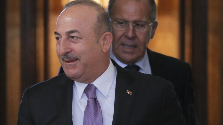 Turkish Foreign Minister Mevlut Cavusoglu (L) and Russian Foreign Minister Sergei Lavrov (R) enter a hall during their meeting in Moscow, Russia, 14 March 2018. According to reports, the meeting was held to discuss settlement in Syria, as well as bilateral military-technical cooperation, including the delivery of S-400 air defense missile systems to Turkey.EPA,MAXIM SHIPENKOV