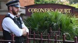 File Photo: A British policeman stands outside Westminster Coroners court in London. EPA, FACUNDO ARRIZABALAGA