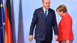 File Photo: German Chancellor Angela Merkel and Turkish President Recep Tayyip Erdogan EPA, LUKAS BARTH