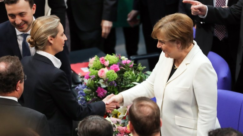 German Chancellor Angela Merkel (R) and Chairman of the Alternative for Germany party (AfD) parliamentary group Alice Weidel (L) shake hands after the election of the Federal Chancellor at the Bundestag in Berlin, Germany, 14 March 2018. EPA, FELIPE TRUEBA