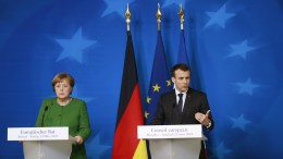 France's President Emmanuel Macron (R) and Germany's Chancellor Angela Merkel (L) at a news conference after the European Council meeting in Brussels, 23 March 2018. The Spring summit of the European Council was focused on economic and trade affairs. EPA,OLIVIER HOSLET