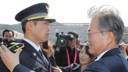 File Photo: President Moon Jae-in (R) places an insignia on a newly commissioned police officer during a joint commissioning ceremony at the Korean National Police University in Asan, South Korea. EPA,YONHAP SOUTH KOREA OUT