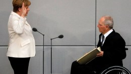 German Chancellor Angela Merkel (L) is sworn in by the President of the German Parliament (Bundestag), Wolfgang Schaeuble (R), on the day of the election of the Federal Chancellor at the Bundestag in Berlin, Germany, 14 March 2018. A coalition of Christian Democratic Union (CDU), Christian Social Union (CSU) and Social Democratic Party (SPD) forms the new German government. EPA, RONALD WITTEK