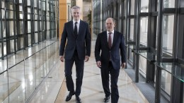 French Finance Minister Bruno Le Maire (L) and German finance minister an vice-chancellor Olaf Scholz (R) walk in the corridors at the Bercy finance ministry in Paris, France, 16 March 2018. Newly-named Olaf Scholz is on his first official visit to France. EPA, IAN LANGSDON